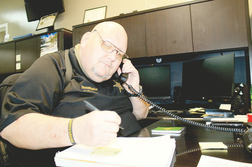 Ken Thomas, an investigator at the Walker County Sheriff's Office spends much of his day on the phone taking drug complaints and getting feedback from citizens who have called the department for assistance.