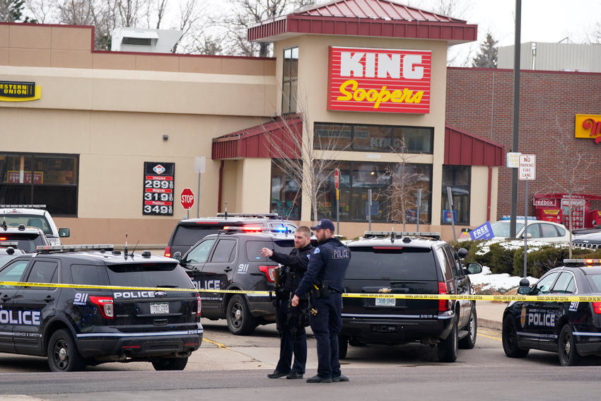 Police outside a King Soopers grocery store where a shooting took place Monday, March 22, 2021, in Boulder, Colo.  (AP Photo/David Zalubowski).............