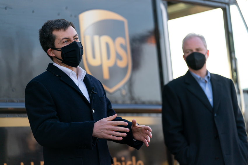Transportation Secretary Pete Buttigieg, joined by  Sen. Chris Van Hollen, D-Md., speaks to media after touring a UPS Facility in Landover, Md., Monday, March 15, 2021. Buttigieg was on hand to highlight COVID-19 vaccine distribution distribution efforts. (AP Photo/Carolyn Kaster)