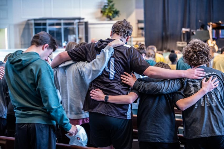 Students gather to pray during the recent D-NOW youth event held at Jasper's First Baptist Church.