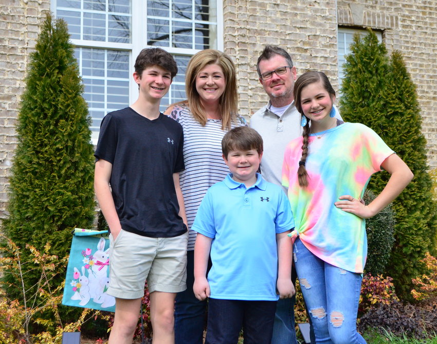 Barry and Amanda Wilson are pictured with their children, Brooks, Millicent and Case, who recovered after a mysterious illness.