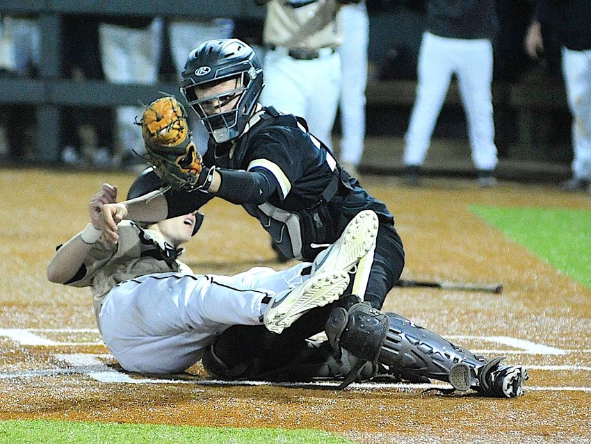 Jasper catcher Connor Whitley tags a Shades Valley out at the plate during their game on Thursday. Jasper swept Minor on Friday.