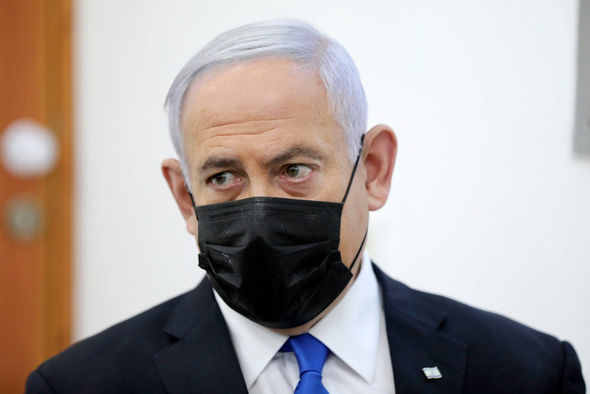 Israeli Prime Minister Benjamin Netanyahu (C) attends a hearing evidence  stage  for his trial over alleged corruption crimes, at the Jerusalem district court, in Salah El-Din, East Jerusalem, 05  April  2021. Netanyahu attends to court to formally respond to the evidence  stage of his  charges of bribery, fraud and breach of trust, just weeks after the national elections.