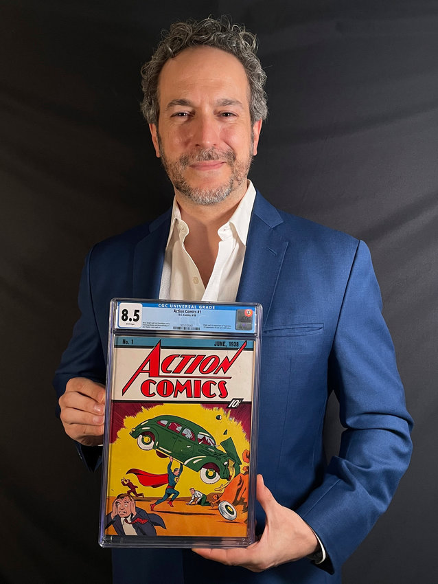 This photo provided on Tuesday, April 6, 2021, shows Vincent Zurzolo,  co-owner of ComicConnect, holding Action Comics first edition 1938 comic book marking  Superman's first appearance, which has sold for a historic, record-breaking $3,250,000. (Metropolis Collectibles via AP)
