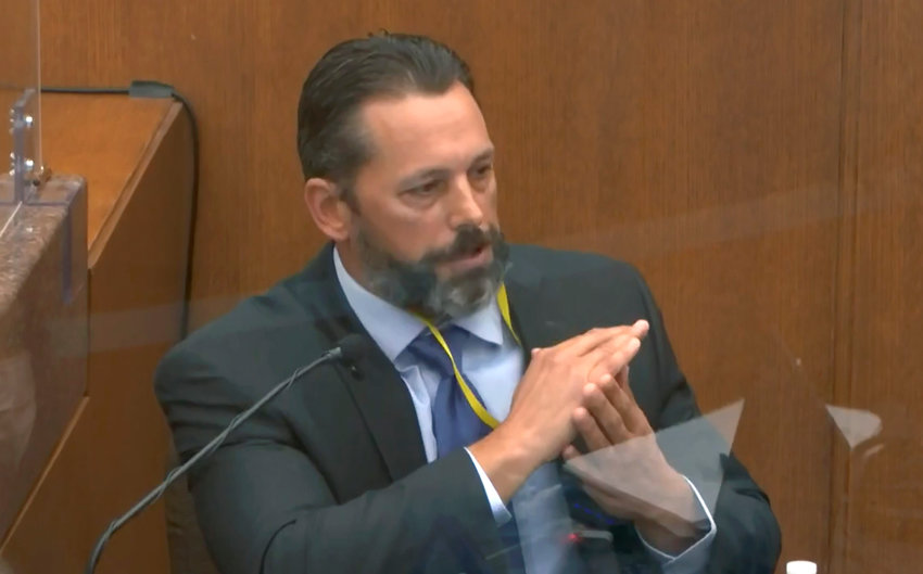 In this image from video, Minneapolis Police Lt. Johnny Mercil, a use of force trainer, testifies as Hennepin County Judge PeterCahill presides Tuesday, April 6, 2021, in the trial of former Minneapolis police Officer Derek Chauvin at the Hennepin County Courthouse in Minneapolis, Minn. Chauvin is charged in the May 25, 2020 death of George Floyd. (Court TV via AP, Pool)(Court TV via AP, Pool)