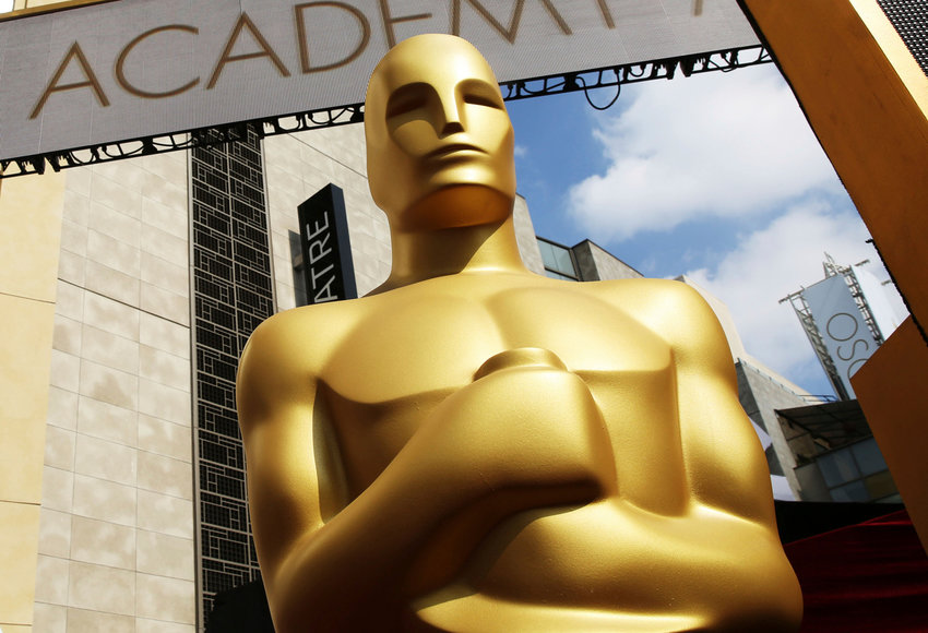 FILE - In this Feb. 21, 2015 file photo, an Oscar statue appears outside the Dolby Theatre for the 87th Academy Awards in Los Angeles. The largest black audience for the Academy Awards over the last dozen years came in 2005, when Chris Rock was host and Jamie Foxx and Morgan Freeman won the top male acting awards. Rock will be back as host this year, but it's an open question how many African American viewers will be tuning in. A lack of diversity in Oscar nominations have led to stars like Spike Lee and Jada Pinkett Smith calling for a boycott of the Academy Awards, scheduled for Feb. 28. (Photo by Matt Sayles/Invision/AP, File)