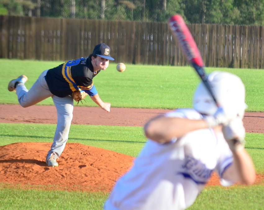 Curry's Luke Smith throws a pitch against Carbon Hill during their game on Thursday.