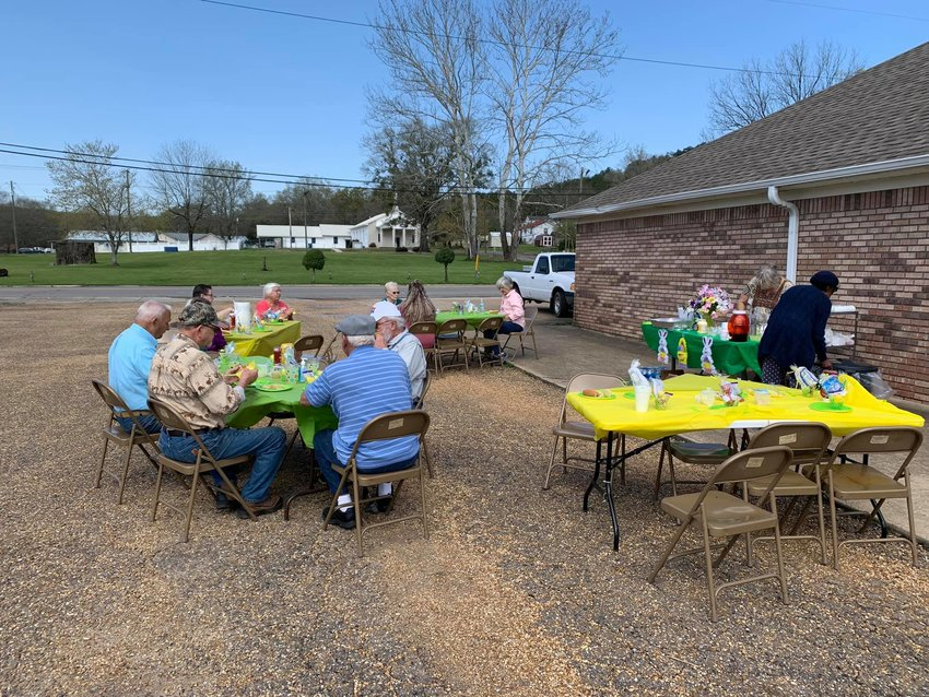 Seniors in Oakman enjoyed a picnic outside the senior center on March 26. Senior centers, which have been closed for activities during the pandemic, can reopen on April 19, though each municipality and senior center director will make the final decision.