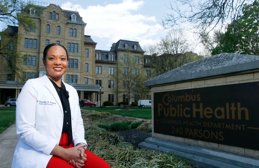 **HOLD FOR PATRICK**Dr. Mysheika W. Roberts, MD, MPH, the health commissioner for Columbus Public Health is seen at her office in Columbus, Ohio. Wednesday, April 14, 2021. (AP Photo/Paul Vernon)