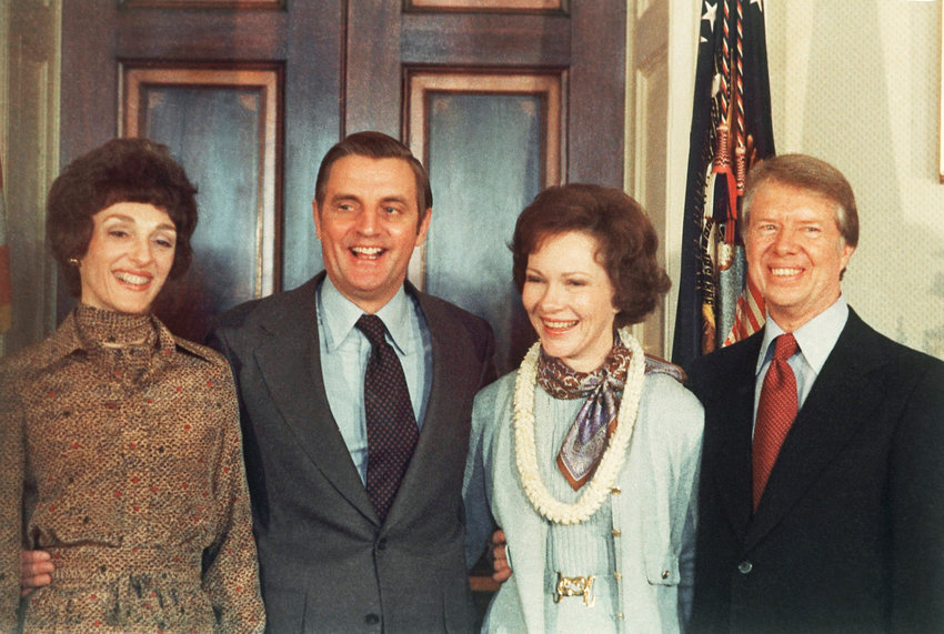 President Jimmy Carter and Mrs. Carter with Vice President and Mrs. Walter Mondale in the informal groups, Jan. 21, 1977, following his inauguration in the White House blue room in Washington. (AP Photo/Peter Bregg)