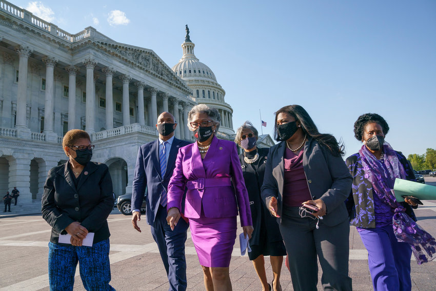 Members of the Congressional Black Caucus walk to make a make a statement on the verdict in the murder trial of former Minneapolis police Officer Derek Chauvin in the death of George Floyd, on Capitol Hill in Washington, Tuesday, April 20, 2021. From left are Rep. Karen Bass, D-Calif., Rep. Andre Carson, D-Ind. Rep. Joyce Beatty, D-Ohio, chair of the Congressional Black Caucus, Rep. Brenda Lawrence, D-Mich., Rep. Cori Bush, D-Mo., and Rep. Sheila Jackson Lee, D-Tex. (AP Photo/J. Scott Applewhite).