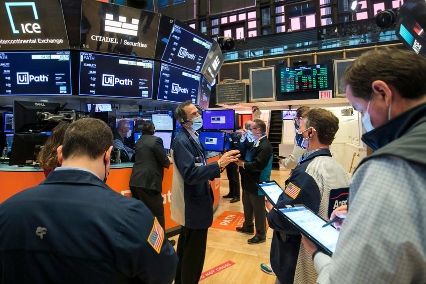 In this photo provided by the New York Stock Exchange, traders work on the floor, Wednesday April 21, 2021. Stocks were mostly higher in afternoon trading Wednesday as investors continued to work through company earnings reports and closely watch the bond market.  (Courtney Crow/New York Stock Exchange via AP)
