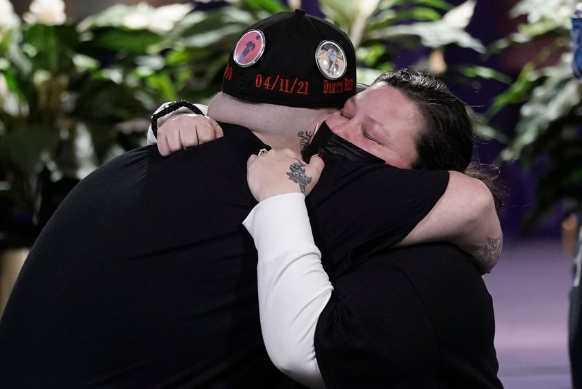 Katie Wright, mother of Daunte Wright, hugs Daunte's brother Damik Bryant during a visitation, Wednesday, April 21, 2021, in Minneapolis. Daunte Wright was fatally shot by a police officer during a traffic stop. (AP Photo/Morry Gash)