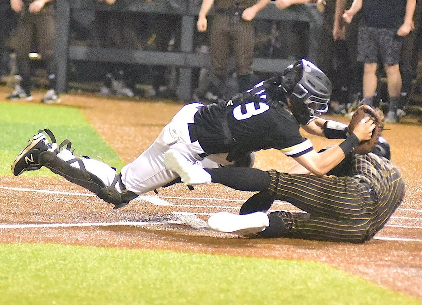 Jasper's Connor Whitley (33) tags out Oxford's Hayes Harrison (17) at the plate during Game 2 of their playoff series on Thursday. Oxford swept Jasper, winning 6-1, 5-2.