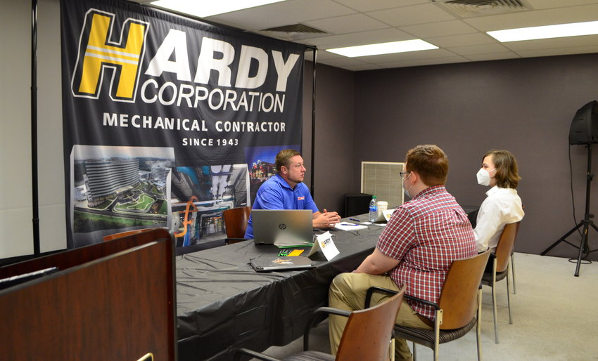 Two seniors are pictured interviewing with a representative of the Hardy Corporation on Thursday at the Walker County Center of Technology.