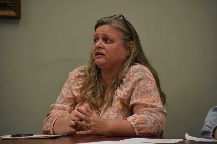 City Clerk Sherry Garner talks to the Carbon Hill City Council Thursday about its options for employee retirement changes.