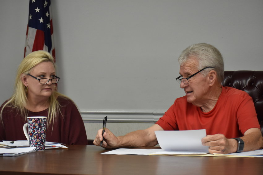 Sumiton Mayor Petey Ellis and City Clerk Nina Absher discuss the proposed change to Tier 1 retirement for city workers during Tuesday's Sumiton City Council meeting. The council later approved the change.