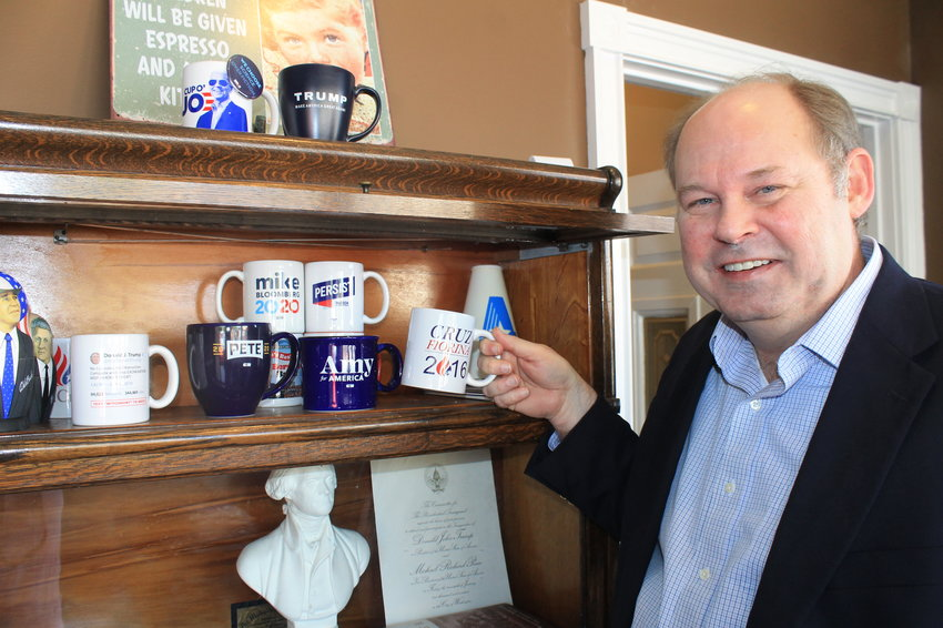Attorney Ken Guin shows off his favorite mug from his presidential campaign mug collection. The Cruz-Fiorina ticket was short-lived in 2016, and Guin got his order in just in the nick of time.
