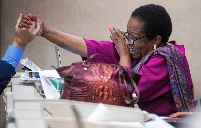 Rep. Laura Hall is congratulated after the Medical Cannabis bill is amended to be named after her son, during debate in the house chamber at the Alabama Statehouse in Montgomery, Ala., on Thursday May 6, 2021. (AP Photo / Montgomery, Advertiser, Mickey Welsh)