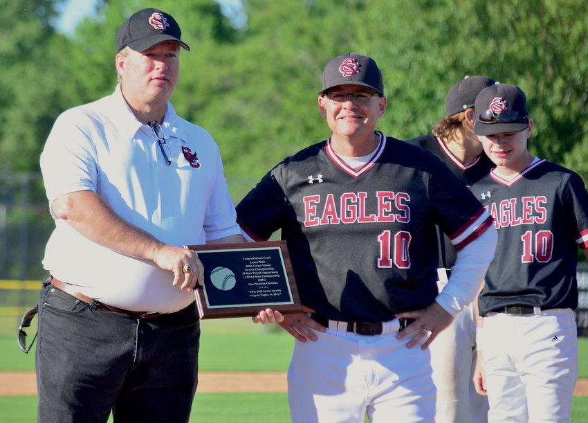 Sumiton Christian Principal James McCleod, left, presents Sumiton Christian baseball coach Lance Blair with a plaque after he earned his 400th career victory on Friday. The Eagles swept the top-ranked Lynn Bears, earning their first trip to the state semifinals since 2004.