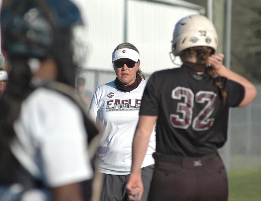 Sumiton Christian softball coach Jessica Aderholt talkes with Jessie Baughan (32) during a game last month. The Covid-19 pandemic ended the 2020 softball season in March, ending any chances of the Eagles challenging for another state championship.
