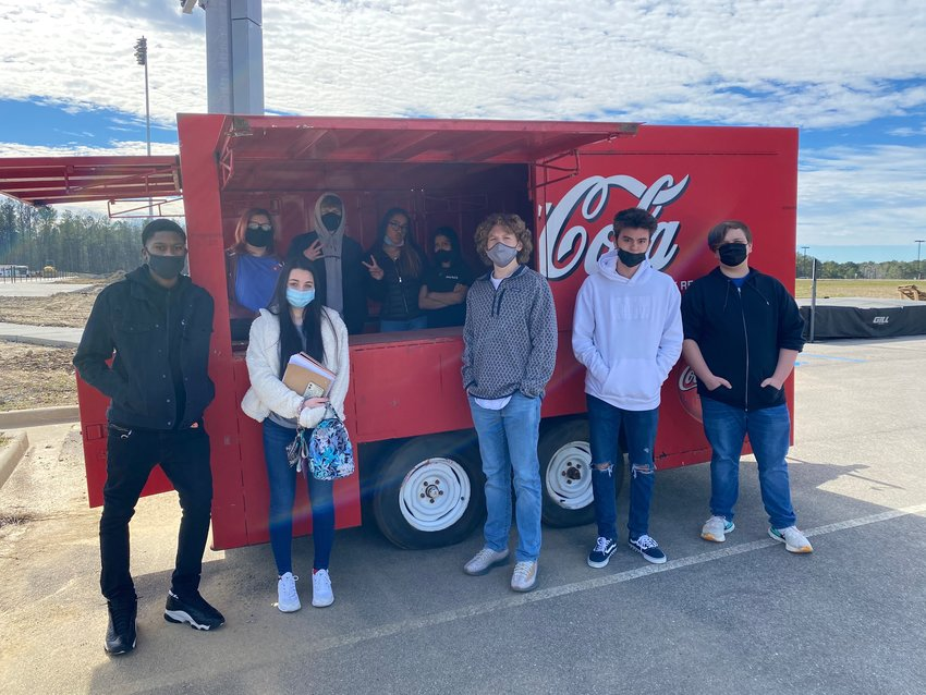Culinary students are pictured in front of a food truck at Jasper High School. The students will be serving food this weekend as part of a culinary competition.
