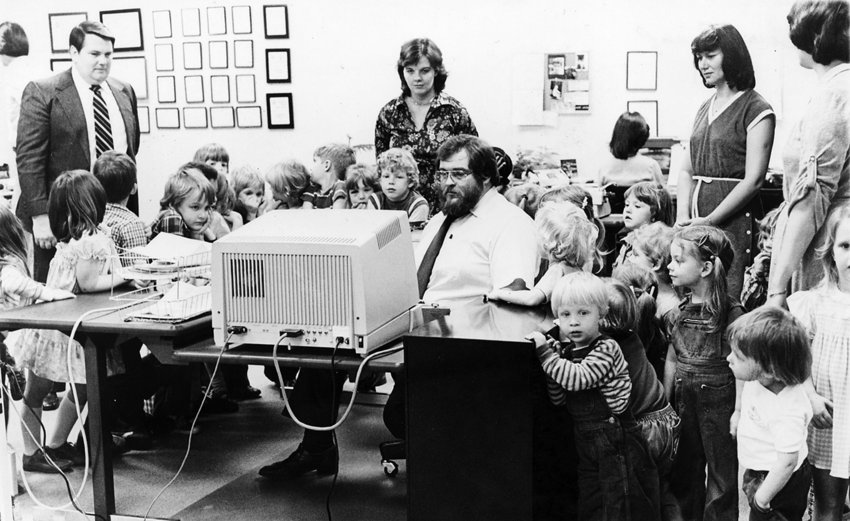 Eagle editor Skip Tucker shows a group of children the 80's-era computers used by newsroom staff in April 1980.
