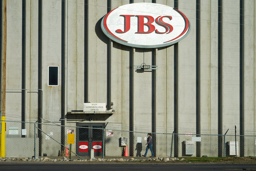 Hold For Release on Friday, Oct. 30, With Patty Nieberg Story slugged Virus Outbreak Lives Lost Meat Plant—A worker heads into the JBS meat packing plant Monday, Oct. 12, 2020, in Greeley, Colo. (AP Photo/David Zalubowski)...