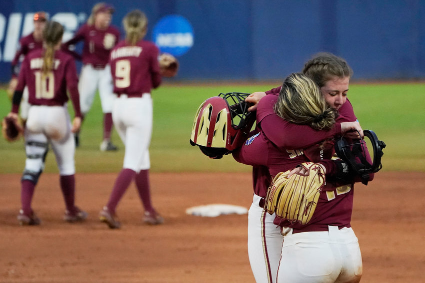 Florida State pitcher Kathryn Sandercock, right, celebrates with catcher Anna Shelnutt after defeating Alabama in an NCAA Women's College World Series softball game, Sunday in Oklahoma City.