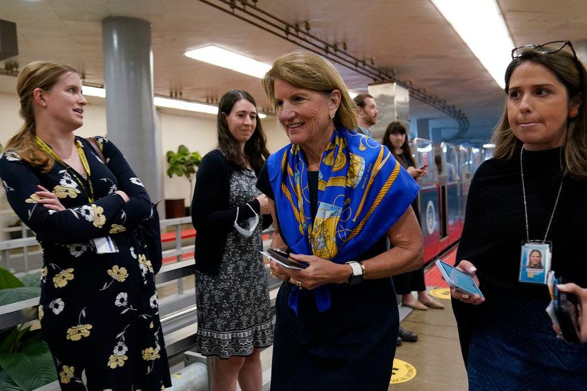 Sen. Shelley Moore Capito, R-W.Va., walks on Capitol Hill in Washington, Tuesday, June 8, 2021. (AP Photo/Susan Walsh)