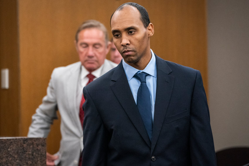 FILE - In this Friday, June 7, 2019, file photo, former Minneapolis police officer Mohamed Noor walks to the podium to be sentenced at Hennepin County District Court in Minneapolis. The Minnesota Supreme Court will hear oral arguments Wednesday, June 9, 2021, in Noor's case, who was convicted of third-degree murder in the shooting death of an Australian woman who had called 911 to report a possible sexual assault behind her home. (Leila Navidi/Star Tribune via AP, Pool, File)