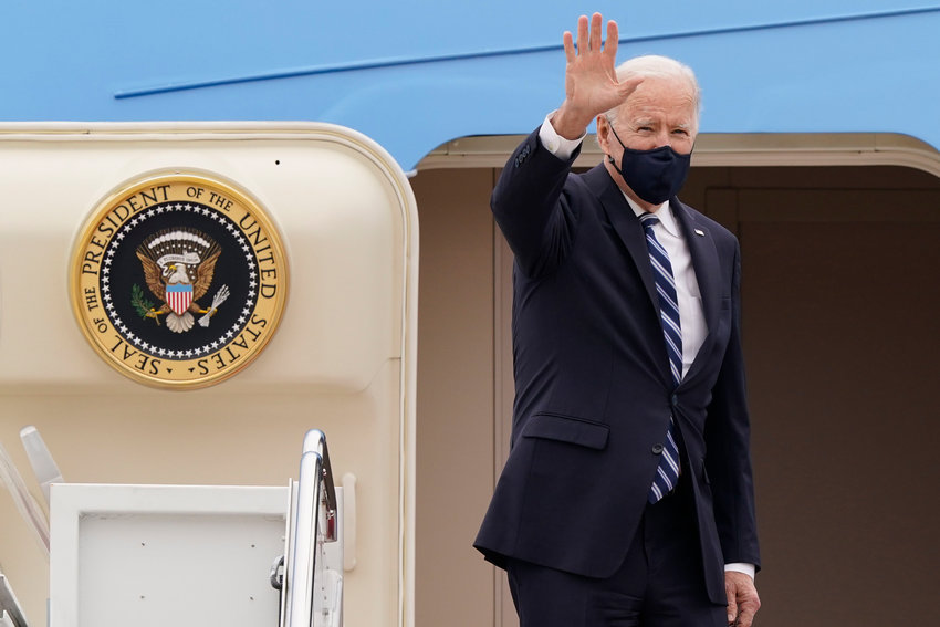 President Joe Biden waves from the top of the steps of Air Force One at Andrews Air Force Base, Md., Tuesday, March 16, 2021, as he prepares to depart for a trip to Pennsylvania.  (AP Photo/Susan Walsh)