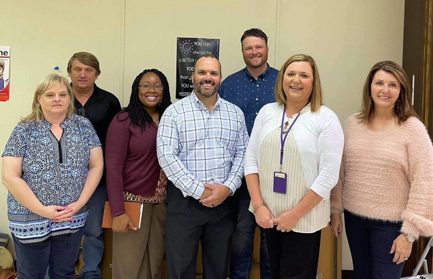 Tina Aaron, at far right, and Anthony Sellers, at back, both of YAP-Jasper, are pictured with members of Saragossa Baptist Church who are helping to create a calming camp at Walker County DHR. Pauletta Windham of the Walker Area Community Foundation and Walker County DHR Director Ginger McGaughy is also pictured.