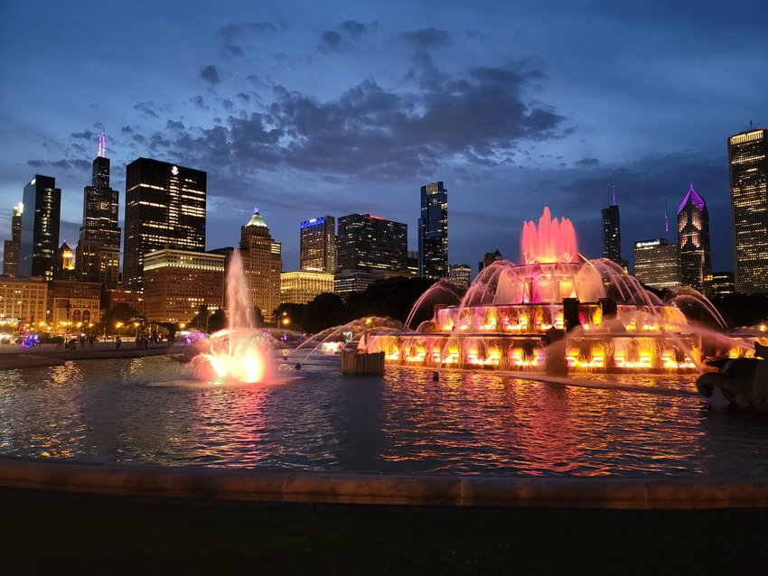 Buckingham fountain rests on the shore of Lake Michigan and provides residents and visitors with a spectacular view of downtown Chicago as it lights up the night.
