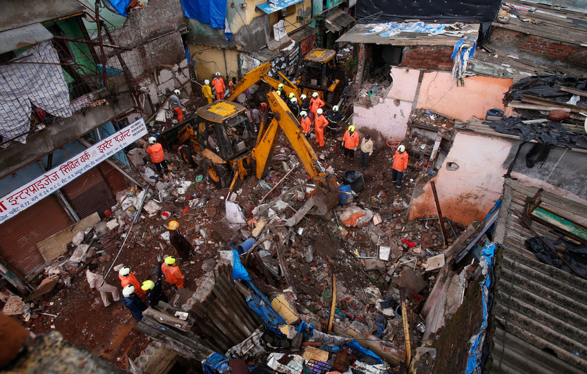 Rescuers work at the site after a three-story dilapidated building collapsed in Mumbai, India, Thursday, June 10, 2021. A three-story dilapidated building collapsed following heavy monsoon rains in the western Indian city of Mumbai, killing at least 11 people and injuring seven others, police said Thursday.(AP Photo/Rafiq Maqbool)