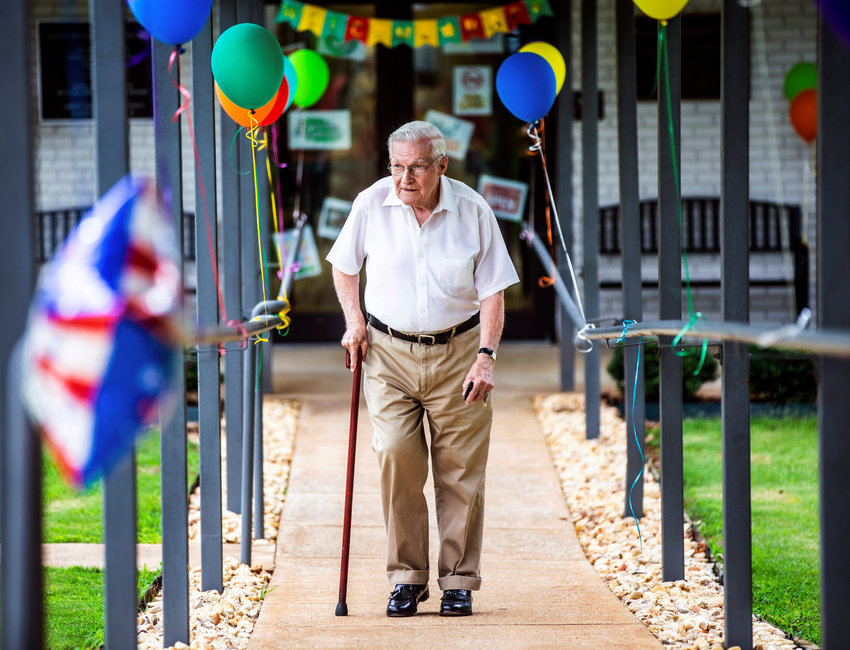 Roger McNeece walks past decorations while leaving to beat the incoming rain as Muscle Shoals Senior Living Center opens to guests on Tuesday, June 8, 2021 in Muscle Shoals, Ala. [DAN BUSEY/TIMESDAILY]