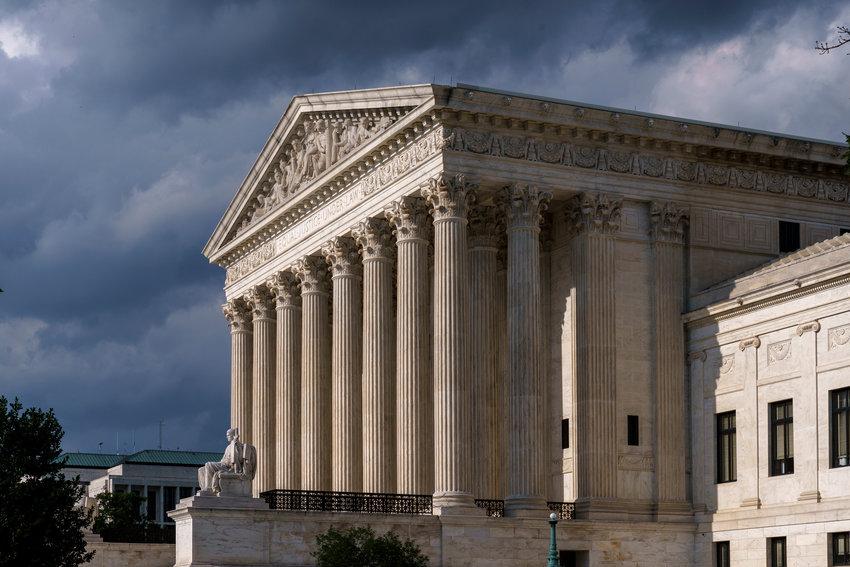 The Supreme Court is seen under threatening skies in Washington, Tuesday, June 8, 2021.  (AP Photo/J. Scott Applewhite)..