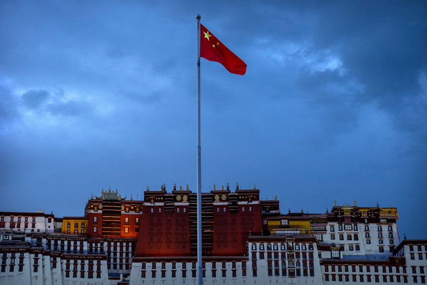 The Chinese flag flies at a plaza near the Potala Palace in Lhasa in western China's Tibet Autonomous Region, Tuesday, June 1, 2021, as seen during a government organized visit for foreign journalists. High-pressure tactics employed by China's ruling Communist Party appear to be finding success in separating Tibetans from their traditional Buddhist culture and the influence of the Dalai Lama. (AP Photo/Mark Schiefelbein)