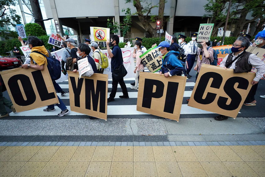 FILE - In this May 9, 2021, file photo, people who are against the Tokyo 2020 Olympics set to open in July, march to protest around Tokyo's National Stadium during an anti-Olympics demonstration. Public sentiment in Japan has been generally opposed to holding the Tokyo Olympics and Paralympics. This is partly based of fears the coronavirus will spike as almost 100,000 people — athletes and others — enter for both events.(AP Photo/Eugene Hoshiko, File)