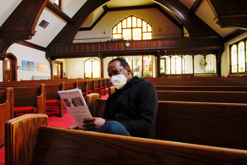 In this photo taken May 6, 2021, Michael Adkins sits in the sanctuary of St. Matthews CME after receiving a vaccination. It's one of the churches that was part of an effort with Pastors United, Milwaukee Inner City Congregations Allied for Hope, Souls to the Polls and the local health clinic Health Connections to get people vaccinated directly in churches. (AP Photo/Carrie Antlfinger)