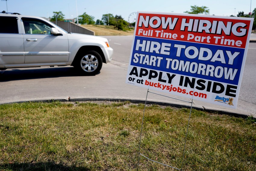 A hiring sign shows in Vernon Hills, Ill., Friday, June 11, 2021. Barely more than a year after the coronavirus caused the steepest economic fall and job losses on record, the speed of the rebound has been so unexpectedly swift that many companies can't fill jobs or acquire enough supplies to meet a pent-up burst of customer demand. (AP Photo/Nam Y. Huh)
