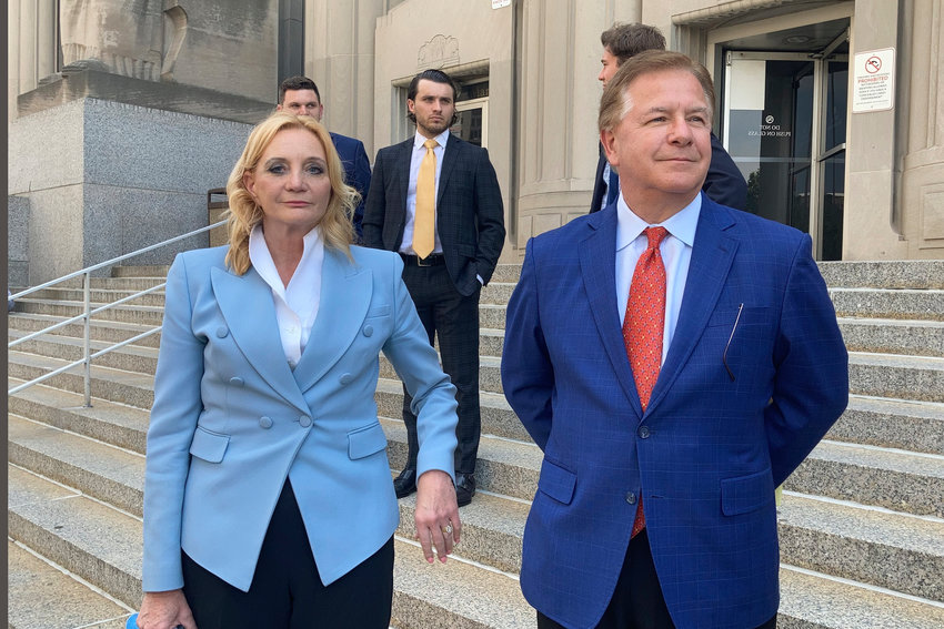 Patricia McCloskey and her husband Mark McCloskey are seen leaving court in St. Louis Thursday, June 17, 2021. The St. Louis couple who gained notoriety for pointing guns at social justice demonstrators last year has pleaded guilty to misdemeanor charges. Patricia McCloskey pleaded guilty Thursday to misdemeanor harassment and was fined $2,000. Her husband, Mark McCloskey, pleaded guilty to misdemeanor fourth degree assault and was fined $750. The couple also agreed to forfeit both weapons they used when they confronted protesters in front of their home in June of last year. The McCloskeys came out of their home and waved weapons at the demonstrators.(AP Photo by Jim Salter)