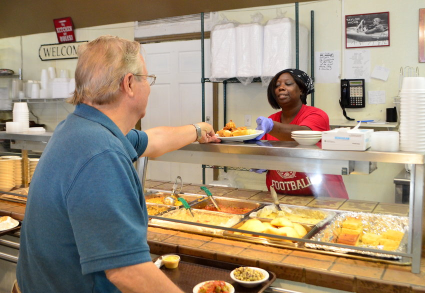 Employees at Victoria's Restaurant in Jasper were busy serving customers on Wednesday.