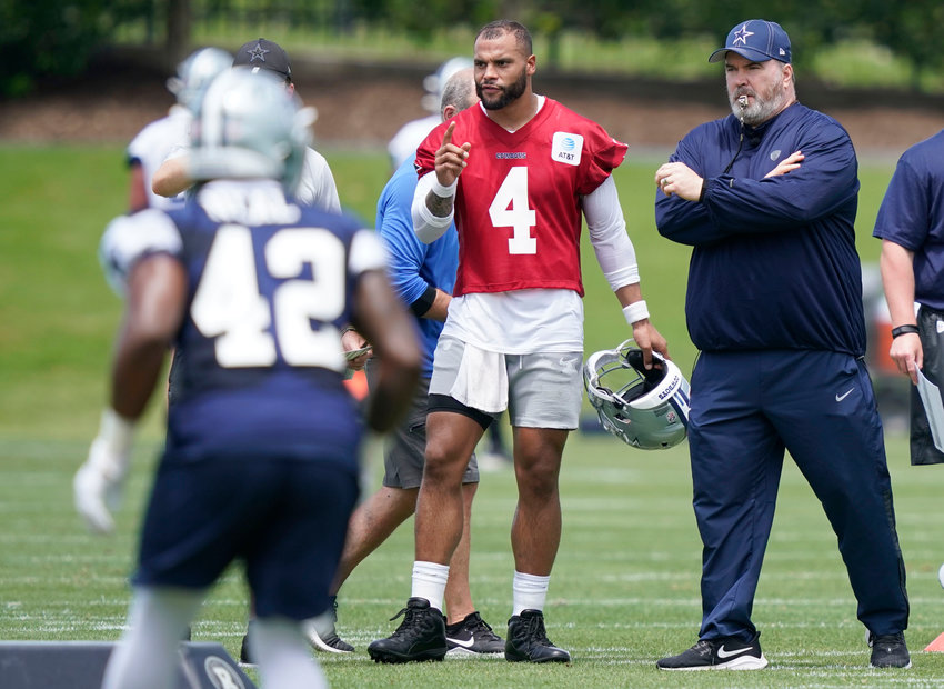 Dallas Cowboys quarterback Dak Prescott (4) stands with head coach Mike McCarthy as they watch drills during an NFL football team practice Tuesday, June 8, 2021, in Frisco, Texas. (AP Photo/LM Otero)