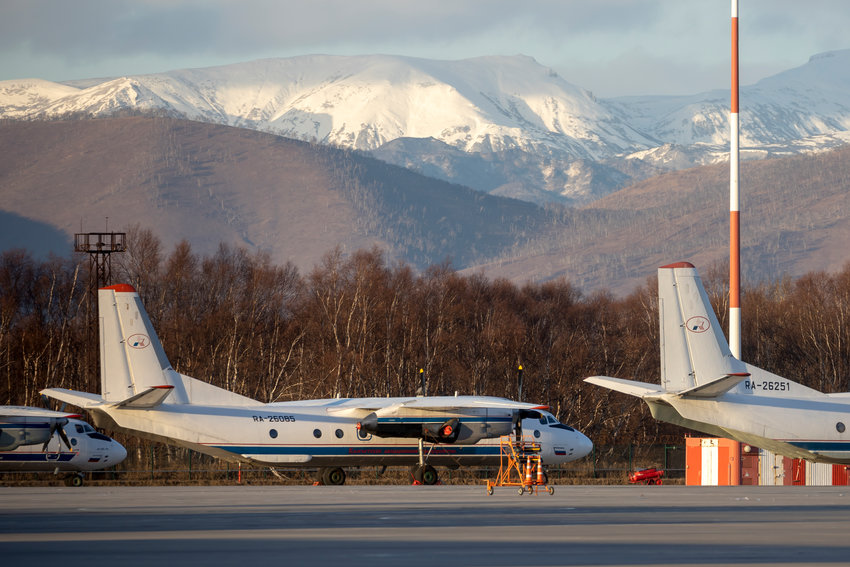 The Antonov An-26 with the same board number #RA-26085 as the missed plane is parked at Airport Elizovo outside Petropavlovsk-Kamchatsky, Russia, Tuesday, Nov. 17, 2020.Local officials say a plane with 28 people on board has gone missing in the Russian Far East region of Kamchatka. Emergency officials say the Antonov An-26 plane with 22 passengers and six crew members missed a scheduled communication while it was flying Tuesday from the city of Petropavlovsk-Kamchatsky to the village of Palana. (AP Photo/Marina Lystseva)