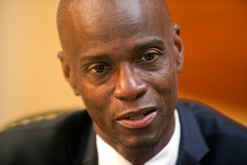 FILE - In this Feb. 7, 2020 file photo, Haiti's President Jovenel Moise speaks during an interview at his home in Petion-Ville, a suburb of Port-au-Prince, Haiti. Haiti is bracing for a fresh round of widespread protests starting Friday, Jan. 15, 2021, with opposition leaders demanding that President Moise step down next month, worried he is amassing too much power as he enters his second year of rule by decree. (AP Photo/Dieu Nalio Chery, File)