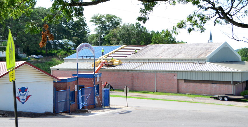 Roof work was underway in Cordova on Friday to renovate a building that will be used for Cordova High School's field house.