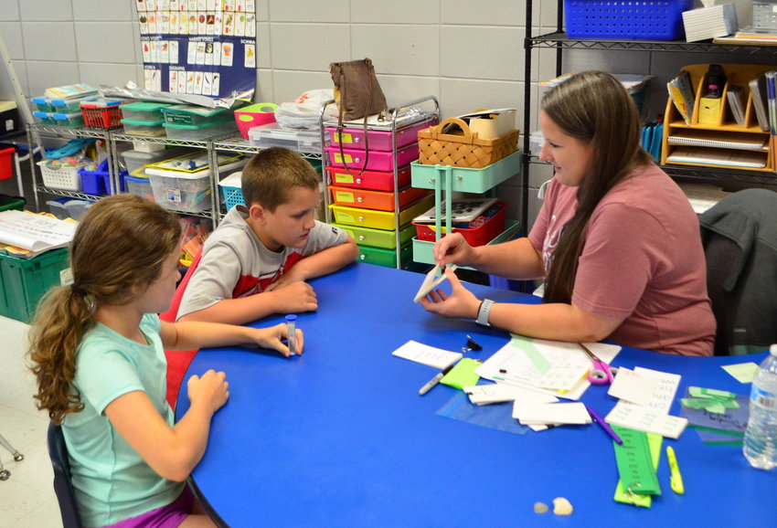 Children at Carbon Hill Elementary are pictured completing an activity to improve their reading skills.