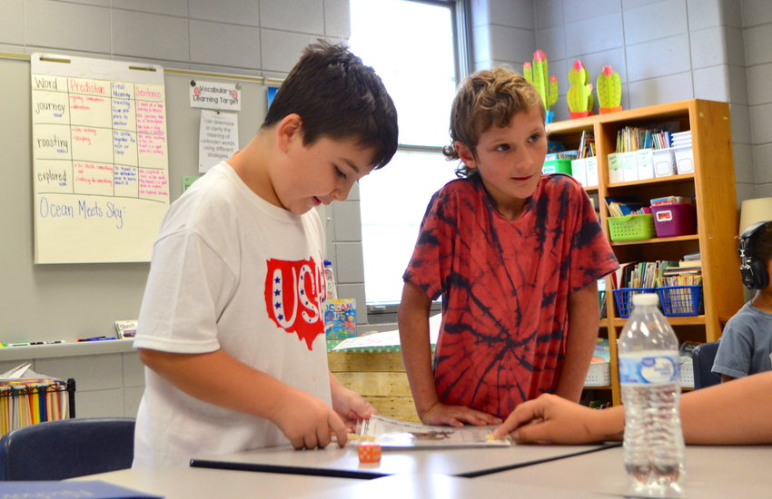 Alabama's Back to School Sales Tax Holiday will begin this Friday and last through Sunday, allowing parents to shop tax-free before school starts back. Pictured are two students in Walker County participating in a summer camp.