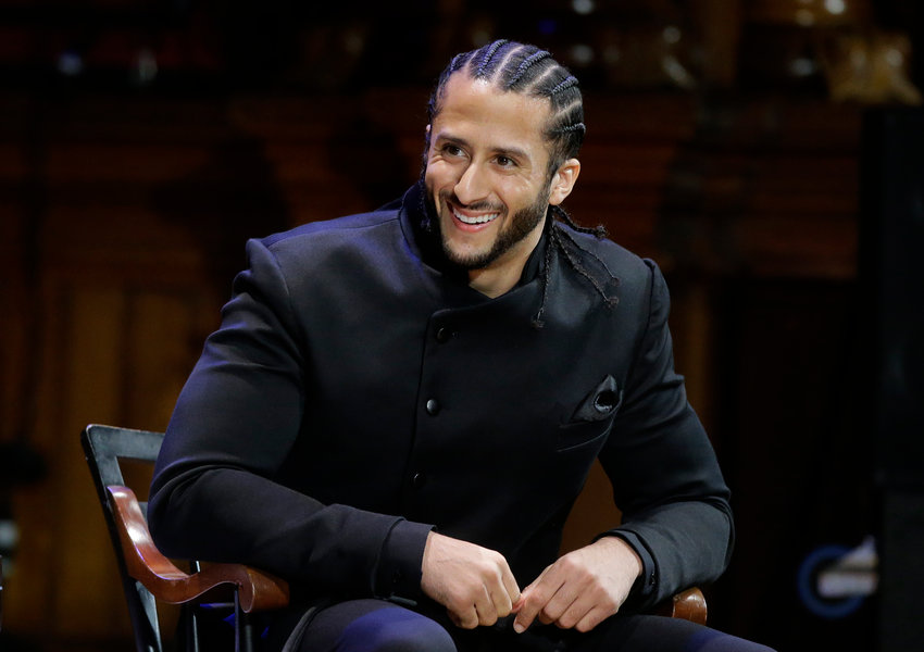 Former NFL football quarterback Colin Kaepernick is seated on stage during W.E.B. Du Bois Medal ceremonies, Thursday, Oct. 11, 2018, at Harvard University, in Cambridge, Mass. Kaepernick is among eight recipients of Harvard University's W.E.B. Du Bois Medals in 2018. Harvard has awarded the medal since 2000 to people whose work has contributed to African and African-American culture. (AP Photo/Steven Senne)